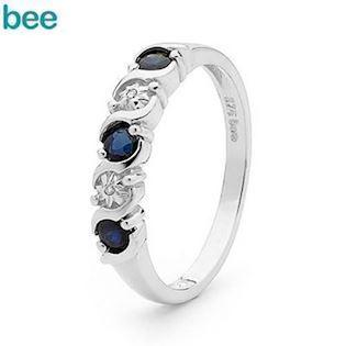 Whitegold diamond and sapphire eternity ring