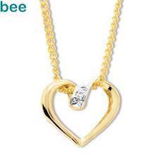 9 ct Sliding gold and Diamond heart